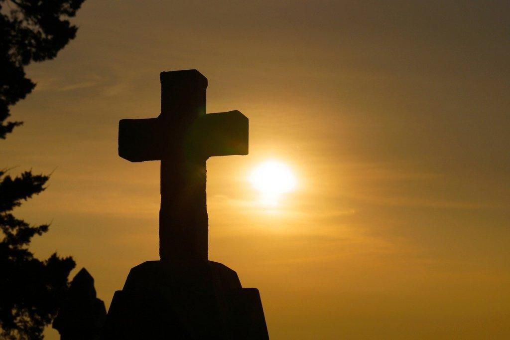 inner peace, silhouette of cross, sunlight in background