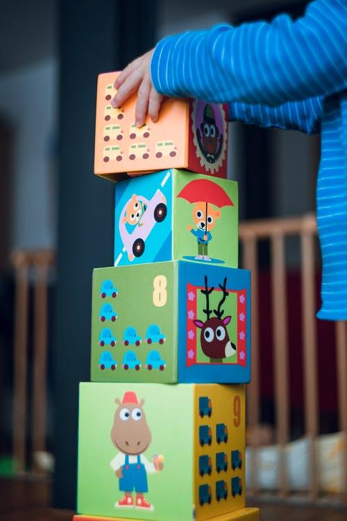 hands of child stacking blocks
