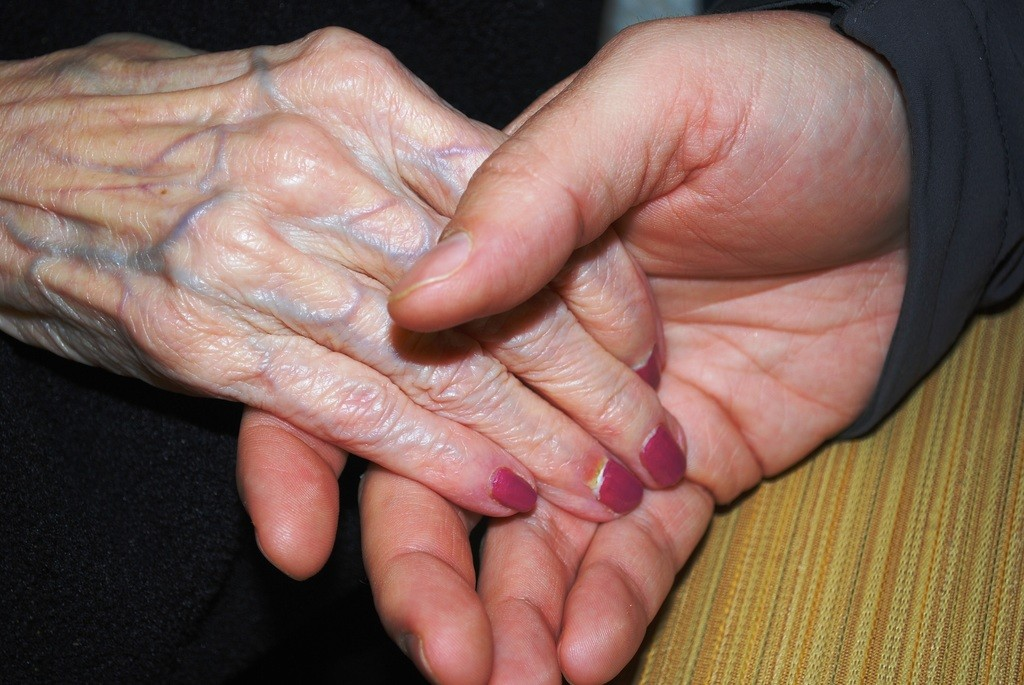 Eulogy holding hands