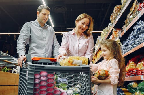 diet, man, woman and child pushing grocery cart