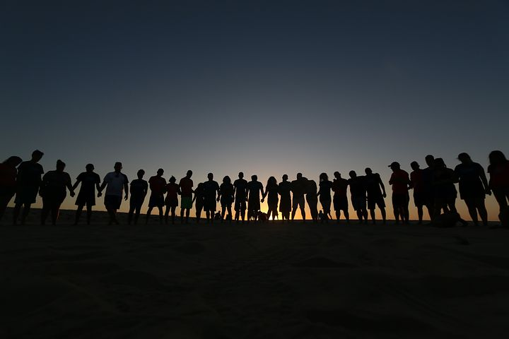 attitude adjustment, group of people on beach
