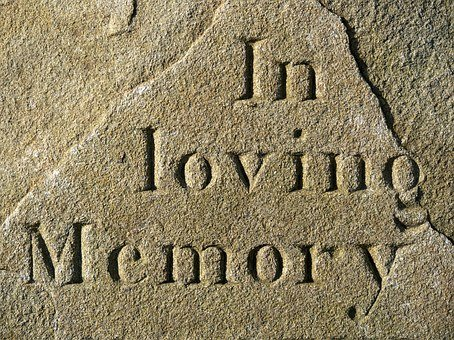 "suicide, stone with engraved words ""in loving memory"""