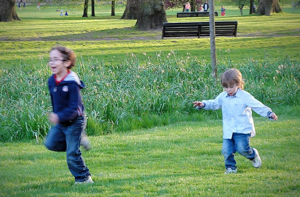 2 Boys running in park