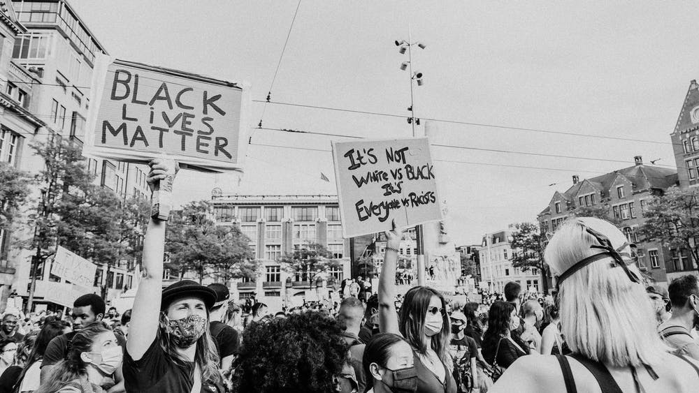 critical race theory, black lives matter protest, people holding signs