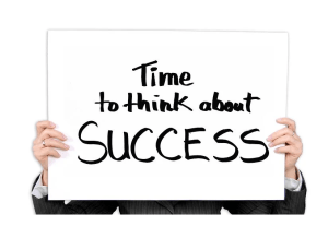 self-improvement, hands holding sign that says time to think about success