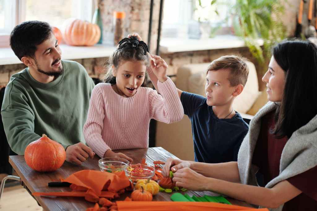 homeschooling ideas, man, woman, girl and boy sitting at table
