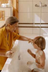 Ashton Kutcher, woman giving child a bath