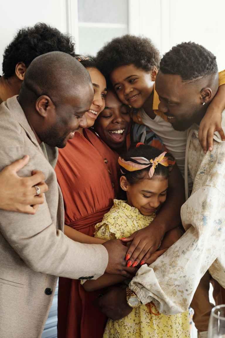 family prayer group, black family in group hug