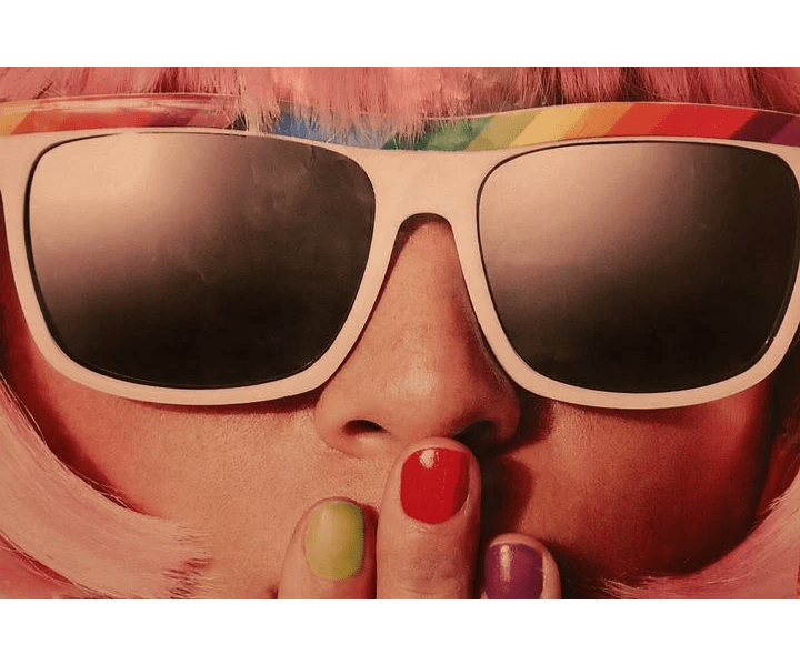 woman, sunglasses, hand on mouth, nails painted various colors