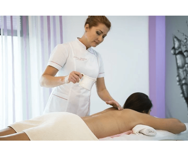 chronic stress, woman in white uniform giving person lying on cot a massage