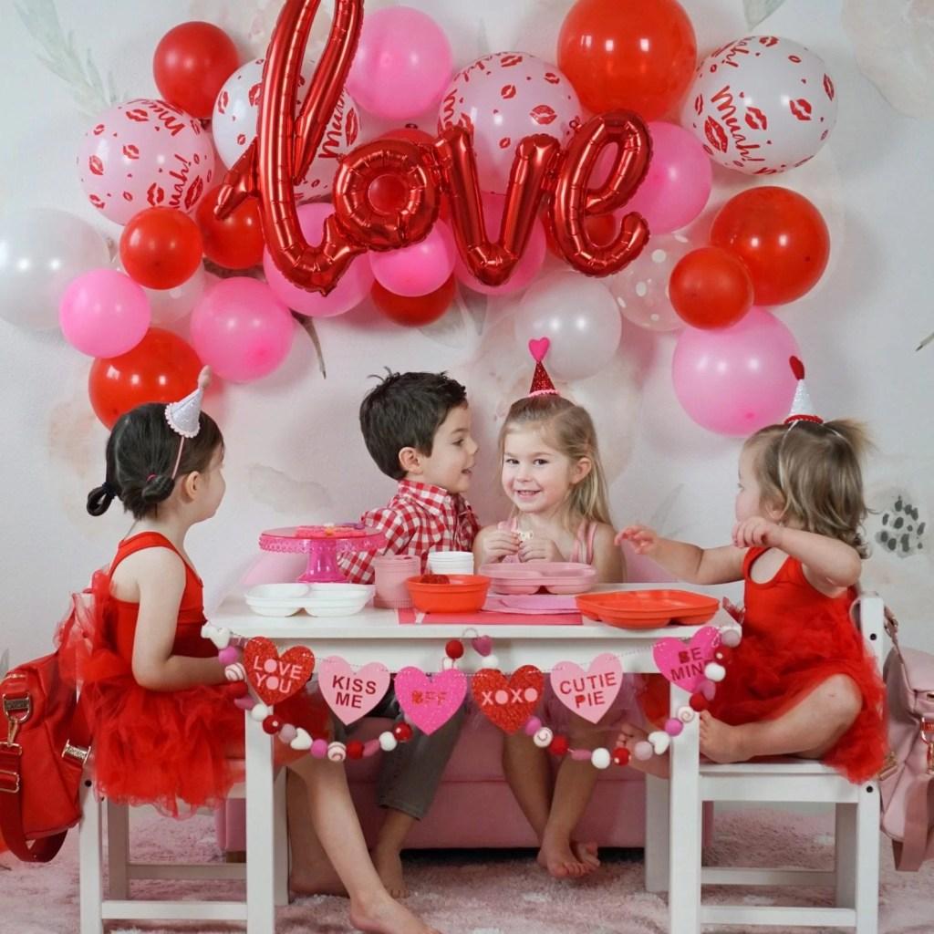 valentine's day-valentine-valentines day party-toddler party-toddler craft-balloon arch-balloon decor-felt ball garland