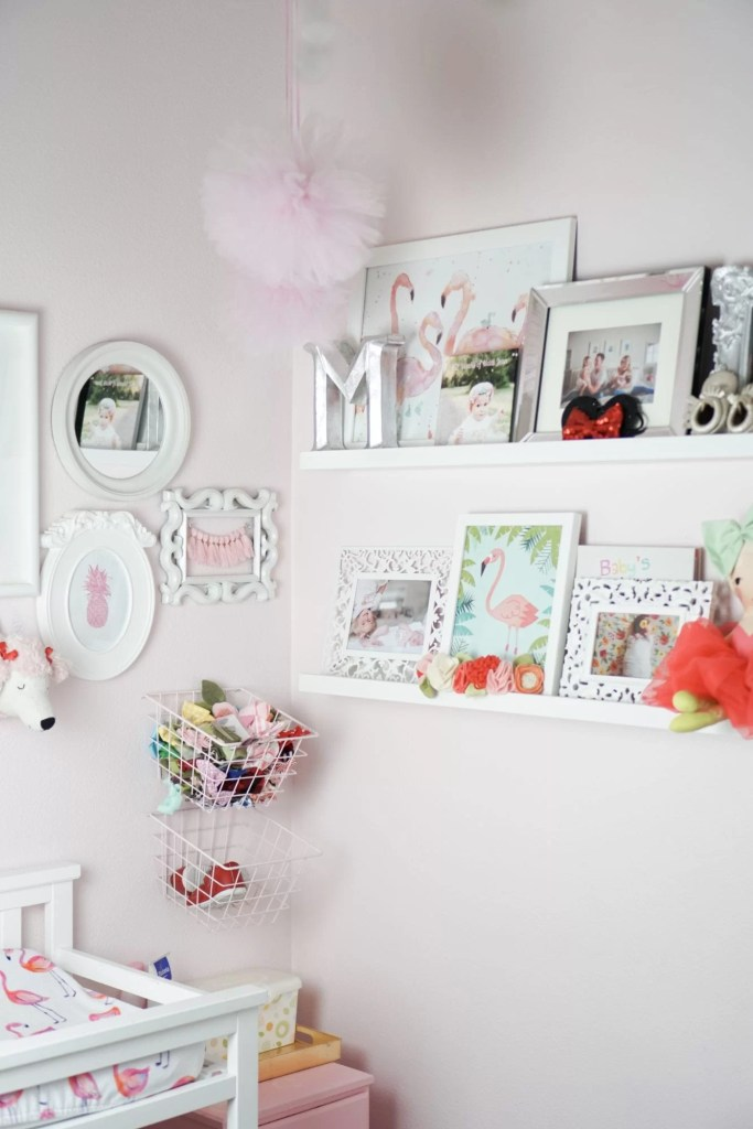 OBSESSED with the Pink Wallpaper in this Baby Girl's Nursery