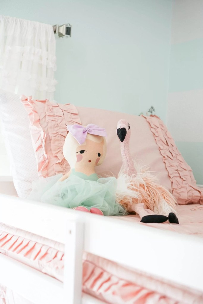 Big girls bedroom update with bunk beds, pink bedding by Beddy's Beds, chandeliers, gold and aqua accents.