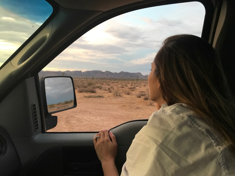 girl looking out the window while driving on a roadtrip
