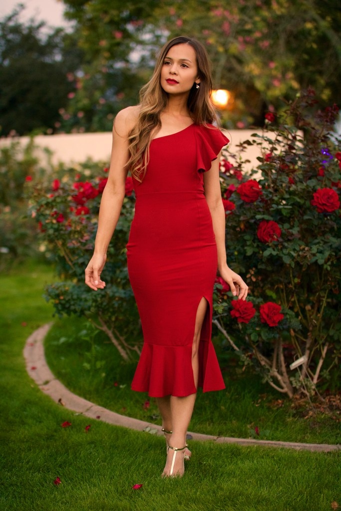 lady in red rose garden elegant holiday perfume