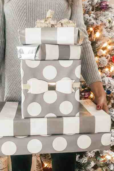 preppy woman holding wrapped gifts