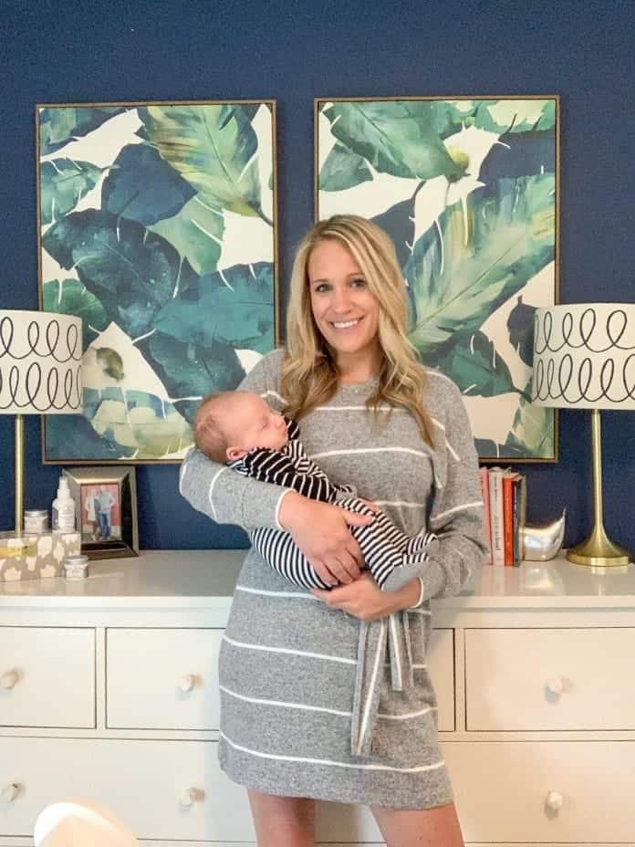 fashionable mom holding baby boy