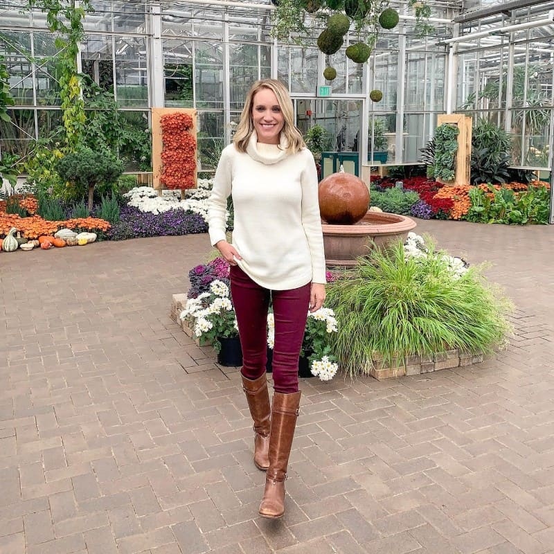 fashion blogger wearing burgundy pants and riding boots