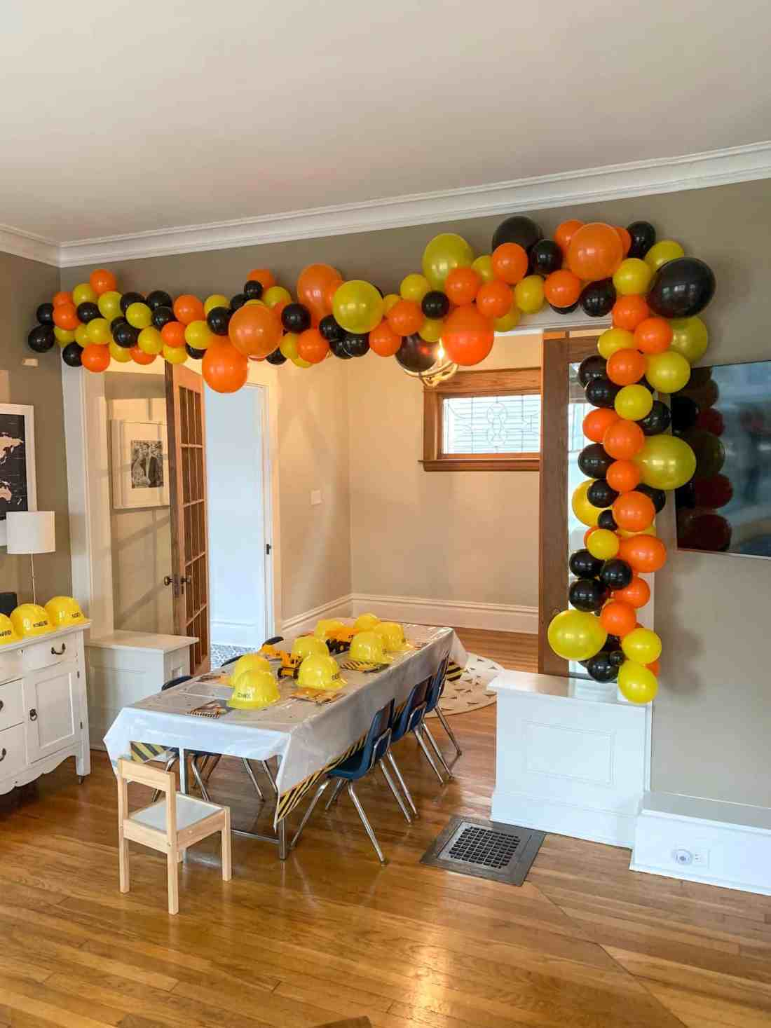 balloon arch at construction theme birthday party