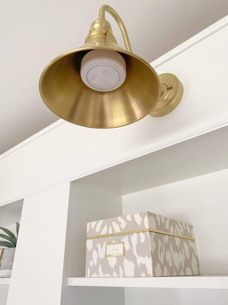 DIY ikea billy bookcase built ins featured by top MI life and style blogger, House of Navy: gold sconce light without hardwiring