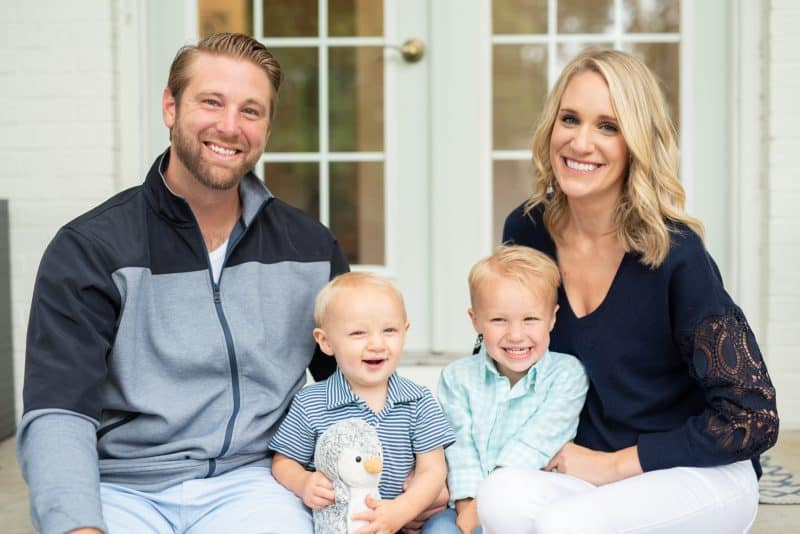 family photon on front porch | Living in Michigan by popular Michigan lifestyle blog, The House of Navy: image of a family sitting together on their front porch.