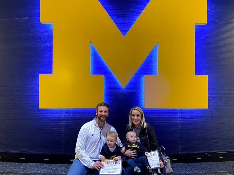 family at Michigan stadium | Living in Michigan by popular Michigan lifestyle blog, The House of Navy: image of a family at the University of Michigan stadium in Ann Arbor, MI.