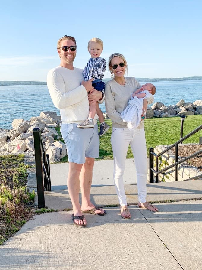 family photo by the lake | Living in Michigan by popular Michigan lifestyle blog, The House of Navy: image of a family in Bay Harbor, MI.