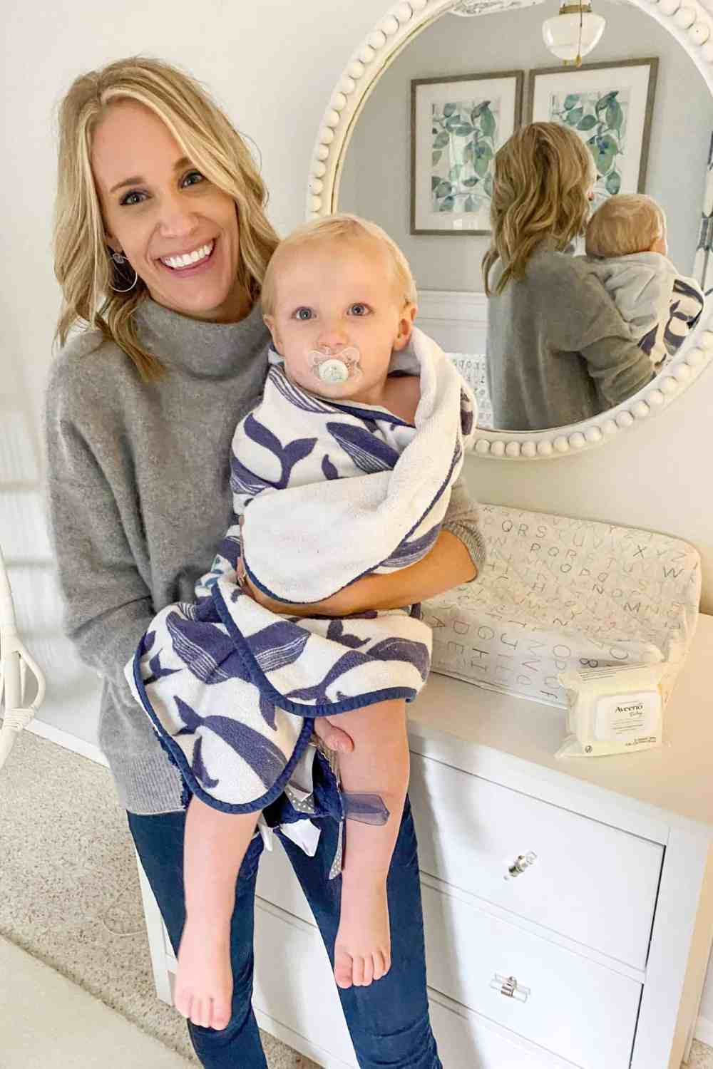 Bath and Bedtime Routine with Aveeno® Baby featured by top Michigan lifestyle blogger, The House of Navy: mom with son after bathtime in towel