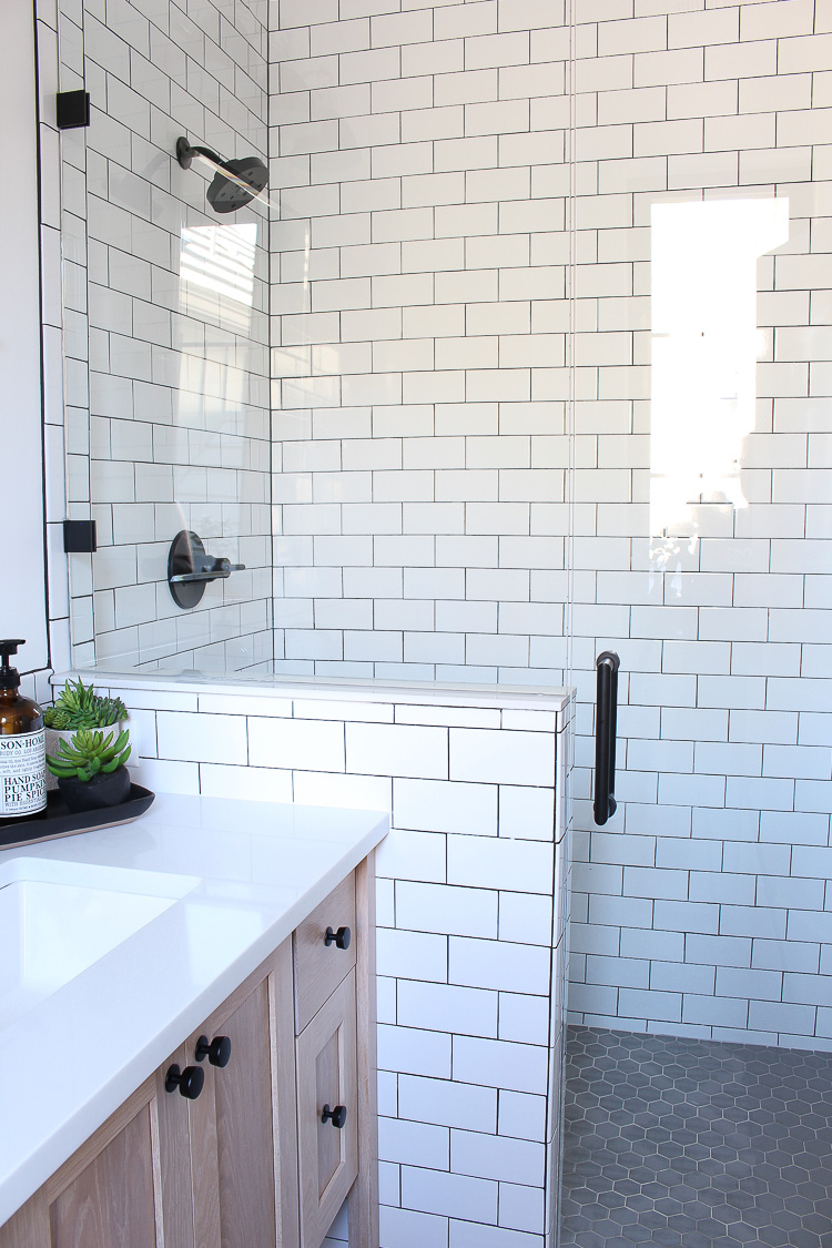 a classic white subway tile bathroom