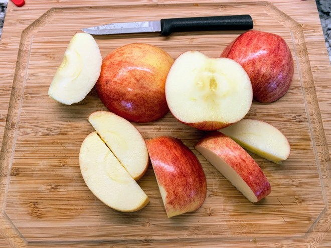 Peel and core the apples for Farmhouse Apple Fritter Bread with Cider Glaze