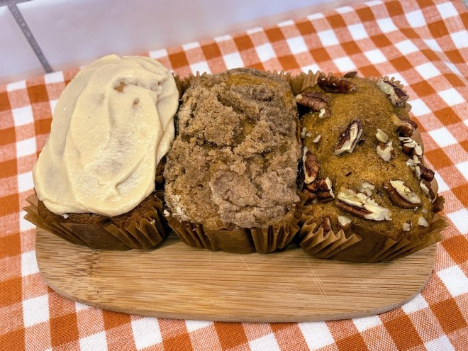 Maple Brown Butter Frosting, Cinnamon Steusel Crumb Topping or chopped pecans top mini pumpkin loaves.