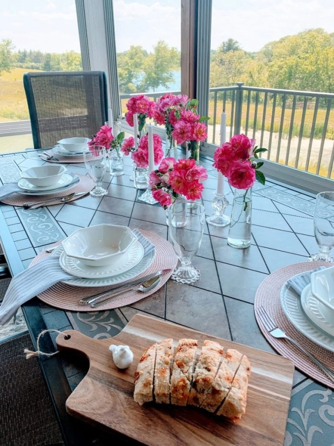Summer Table with Glass Bottle Centerpiece