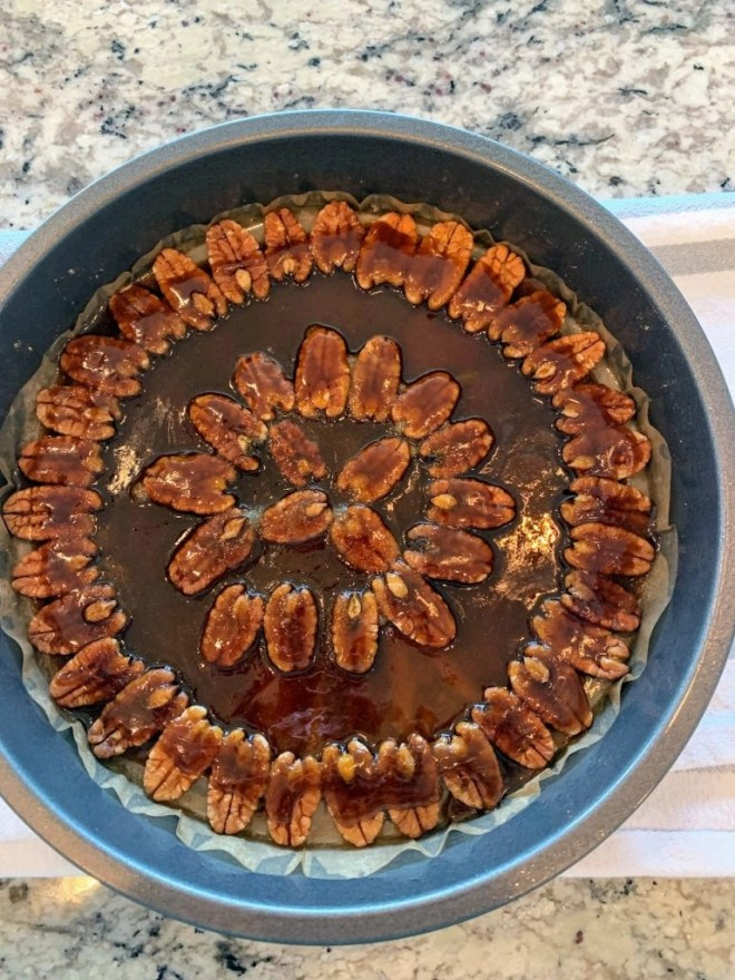 Arrange the pecan halves in the bottom of the pan to create the top of the pumpkin cake when turned upside-down.