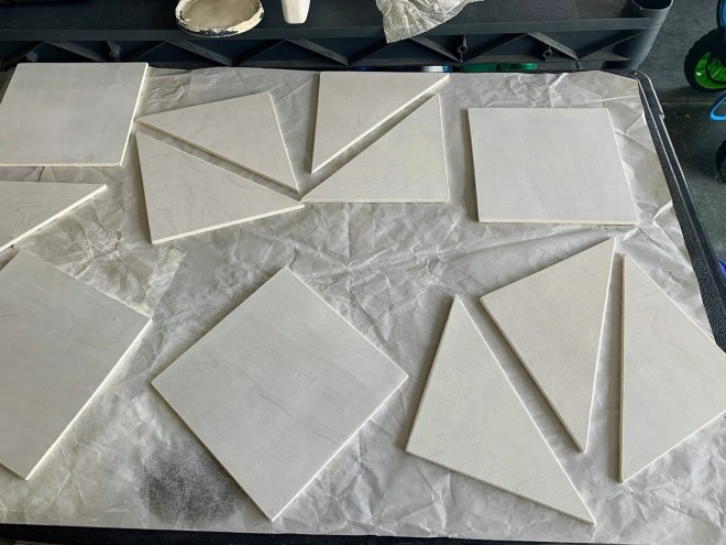 Painted quilt blocks in one color of white for How to Make a Barn Quilt