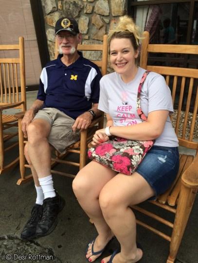 Sitting on the rocking chairs at Ole Smokey Moonshine.