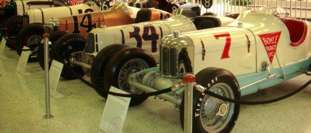 Vintage race cars in the Hall of Fame showroom