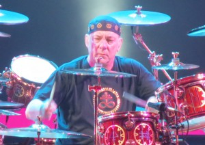 Drummer Neil Peart performing with Rush in 2012 (photo by Clalansignh via WikiCommons)