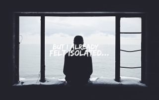 Person sitting alone in the dark feeling isolated