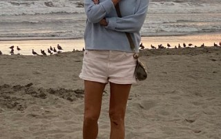 Woman standing on beach unconcerned with judgment