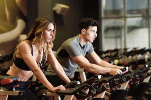 couple doing exercise in fit gym clothes
