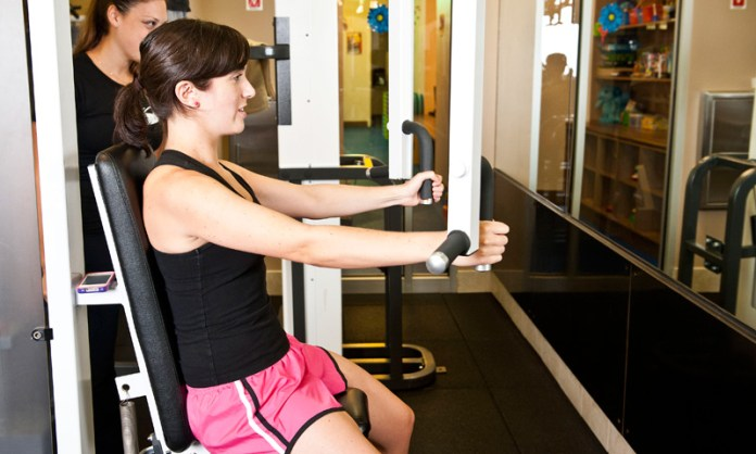 fit woman doing rear delt fly exercise