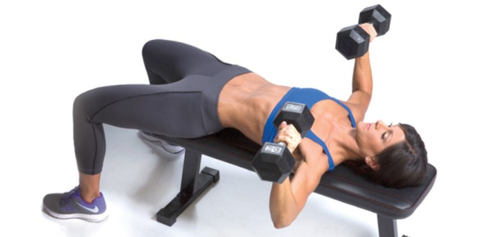 fit woman doing dumbbell bench press exercise for upper body