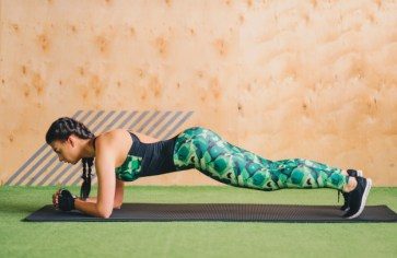 healthy woman doing plank exercise