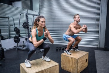 couple doing jumping squats