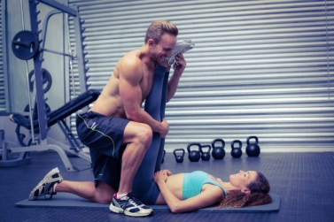 couple doing legs up exercise