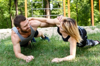 young-blonde-woman-bearded-man-doing-exercise-plank-together
