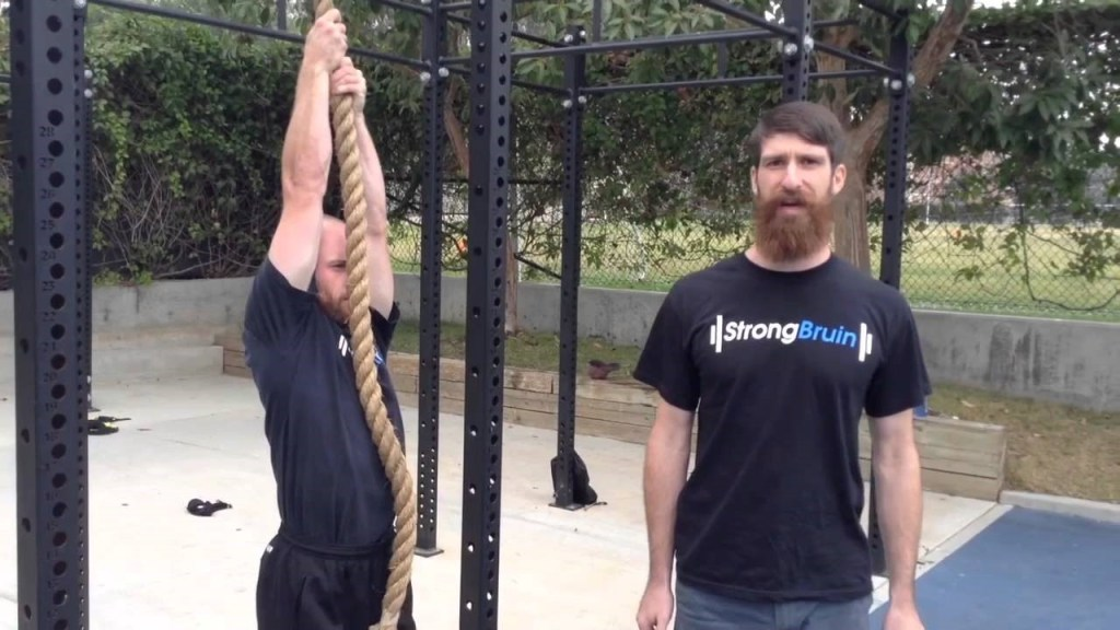 bearded man doing rope pull-up hang