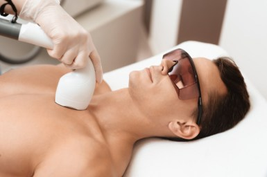 man getting laser hair removal