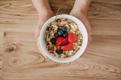 top-view-person-holding-muesli-bowl_fiber