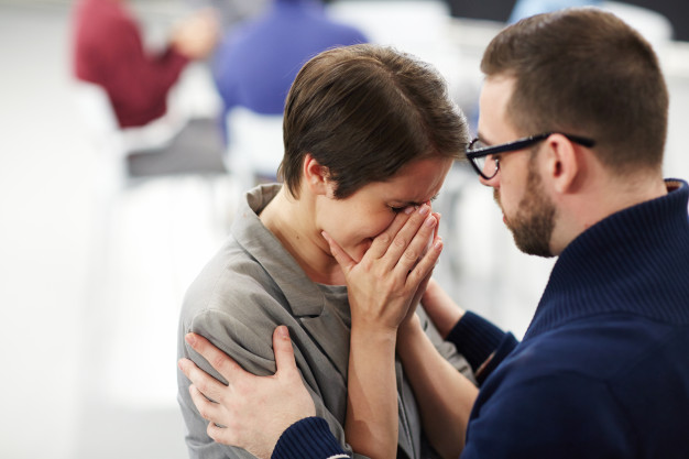 man giving woman emotional support
